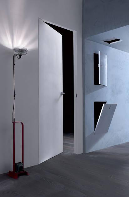 La collezione Essential degli sportelli filo muro Scrigno